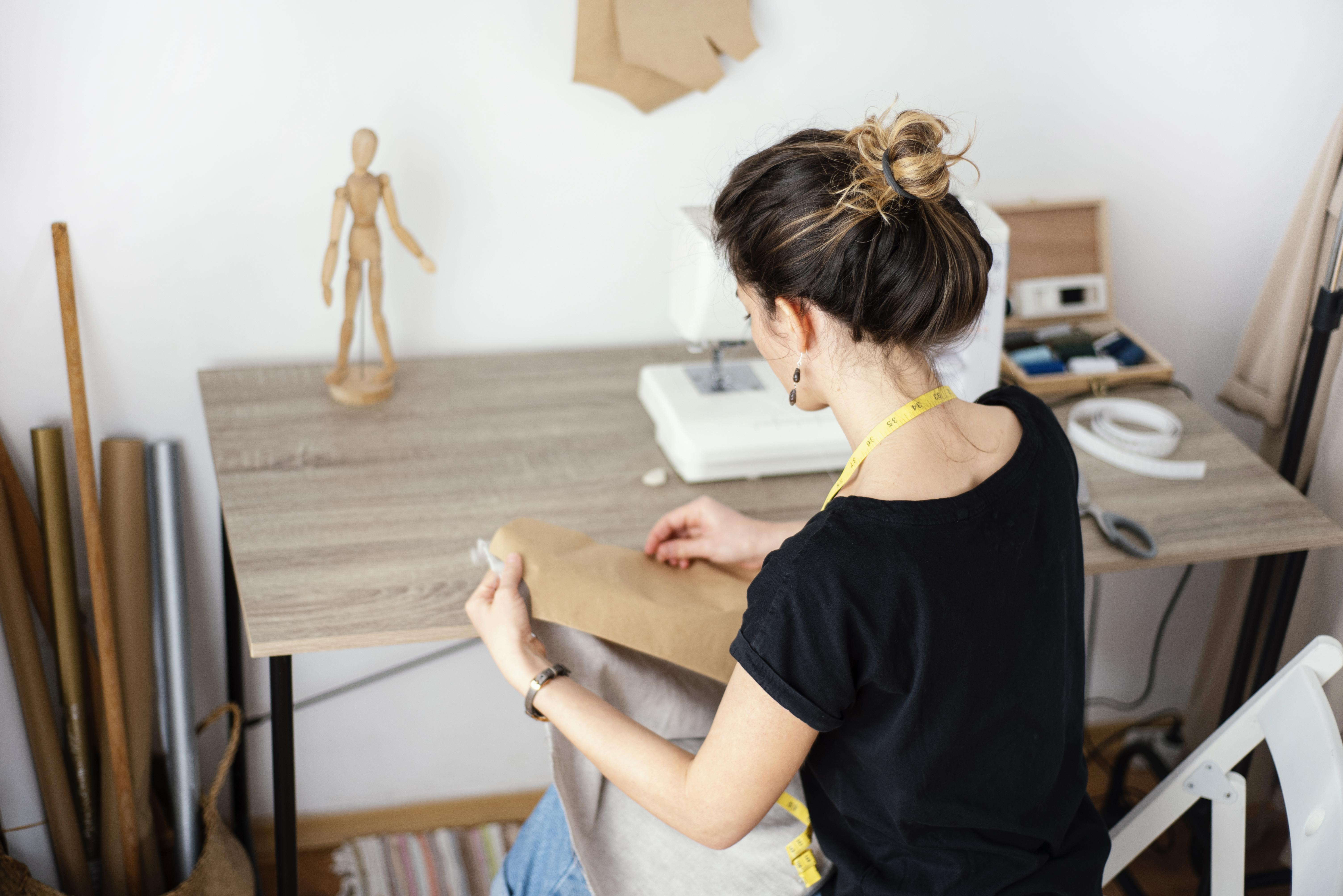 high-angle-of-female-tailor-working-in-the-studio.jpg